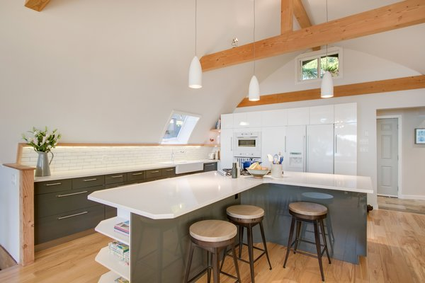 Modern home with kitchen, engineered quartz counter, white cabinet, wood counter, tile counter, medium hardwood floor, subway tile backsplashe, ceiling lighting, wall oven, cooktops, refrigerator, microwave, and dishwasher. Kitchen  Photo 8 of Bayview Road