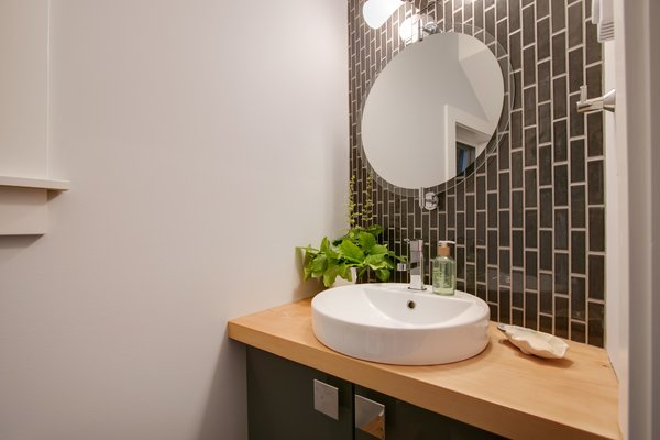 Modern home with bath room, medium hardwood floor, wood counter, and tile counter. Powder room  Photo 17 of Bayview Road