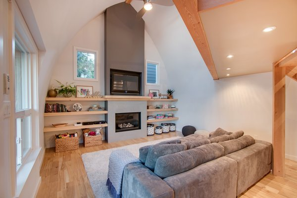 Modern home with living room, sofa, sectional, standard layout fireplace, medium hardwood floor, ceiling lighting, and gas burning fireplace. Den  Photo 9 of Bayview Road