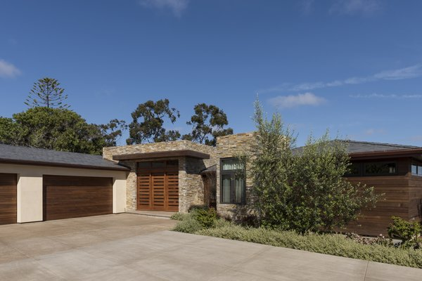 Modern home with outdoor, front yard, concrete patio, porch, deck, and shrubs. La Jolla Exterior Photo  of La Jolla Modern