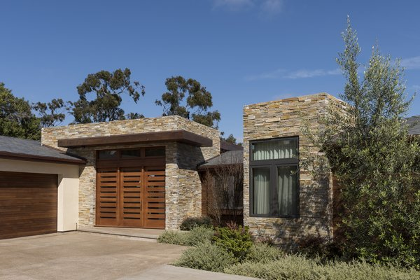 Modern home with outdoor, front yard, small patio, porch, deck, trees, shrubs, and concrete patio, porch, deck. La Jolla Exterior Photo 2 of La Jolla Modern