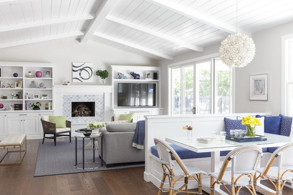 Modern home with living room, bench, bookcase, chair, coffee tables, sectional, end tables, ceiling lighting, gas burning fireplace, and medium hardwood floor. Great Room:  Kitchen Banquette and Family Room Photo 2 of Danville Transitional Remodel