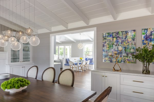 Modern home with dining room, storage, bar, table, pendant lighting, medium hardwood floor, and gas burning fireplace. Forming Living Room turned Formal Dining Room Photo 4 of Danville Transitional Remodel