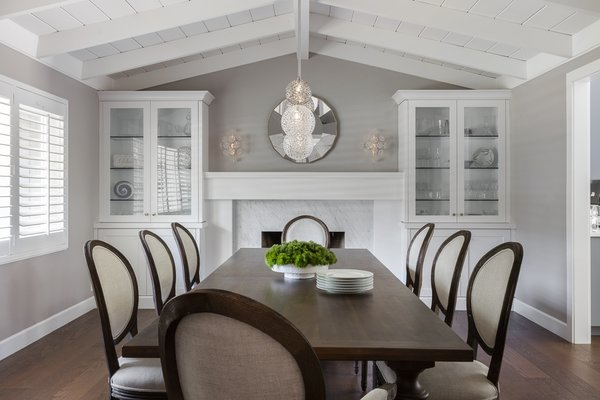 Modern home with dining room, wall lighting, table, medium hardwood floor, pendant lighting, and gas burning fireplace. Formal Dining Room Photo 5 of Danville Transitional Remodel