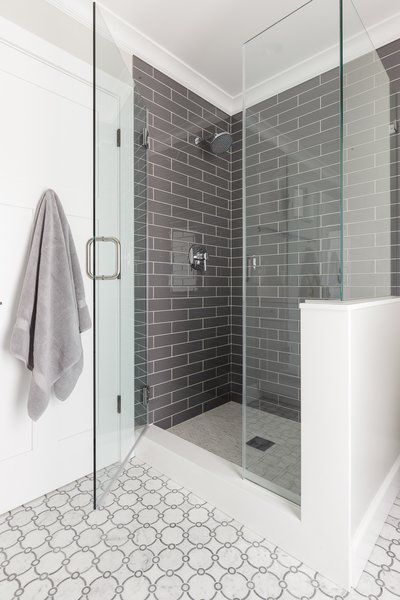 Modern home with bath room, recessed lighting, enclosed shower, subway tile wall, marble floor, and glass tile wall. Guest Bathroom Shower Photo 7 of Danville Transitional Remodel
