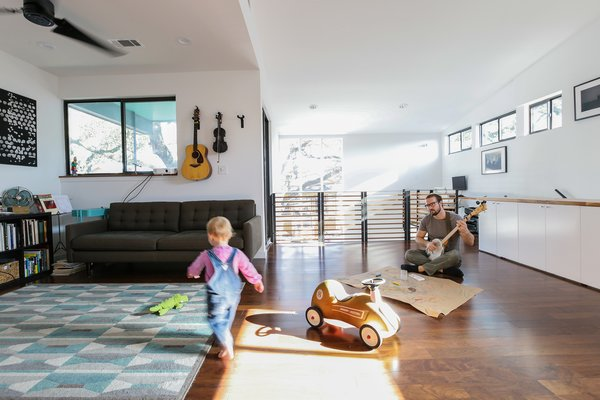 Modern home with living room, ceiling lighting, sofa, and dark hardwood floor. Second floor living spaces Photo 4 of Dorgenois