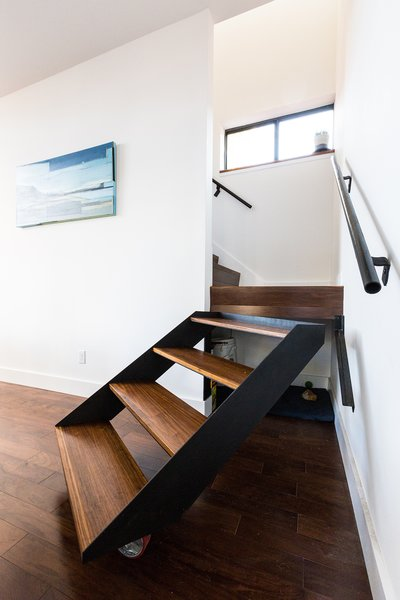 Modern home with storage room and under stairs storage type. The architects, owners of a New Orleans design build firm, fabricated a pivoting stair to allow access to under stair storage. Painting by Tiffany Lin. Photo 7 of Dorgenois