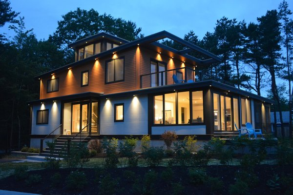 Modern home with outdoor, front yard, walkways, wood patio, porch, deck, and landscape lighting. Exterior southeast Photo  of Eiderdown