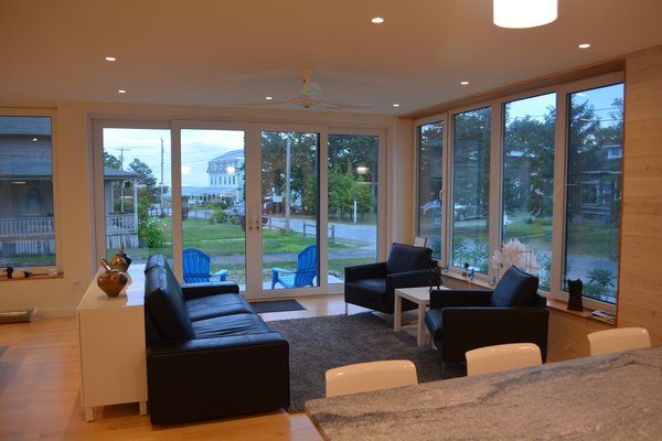 Modern home with recessed lighting, light hardwood floor, kitchen, chair, console tables, sofa, and engineered quartz counter. Living/Dining/Kitchen looking toward the beach Photo 3 of Eiderdown