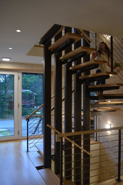 Modern home with staircase, wood tread, metal tread, metal railing, and wood railing. Stair looking toward main entry Photo 6 of Eiderdown
