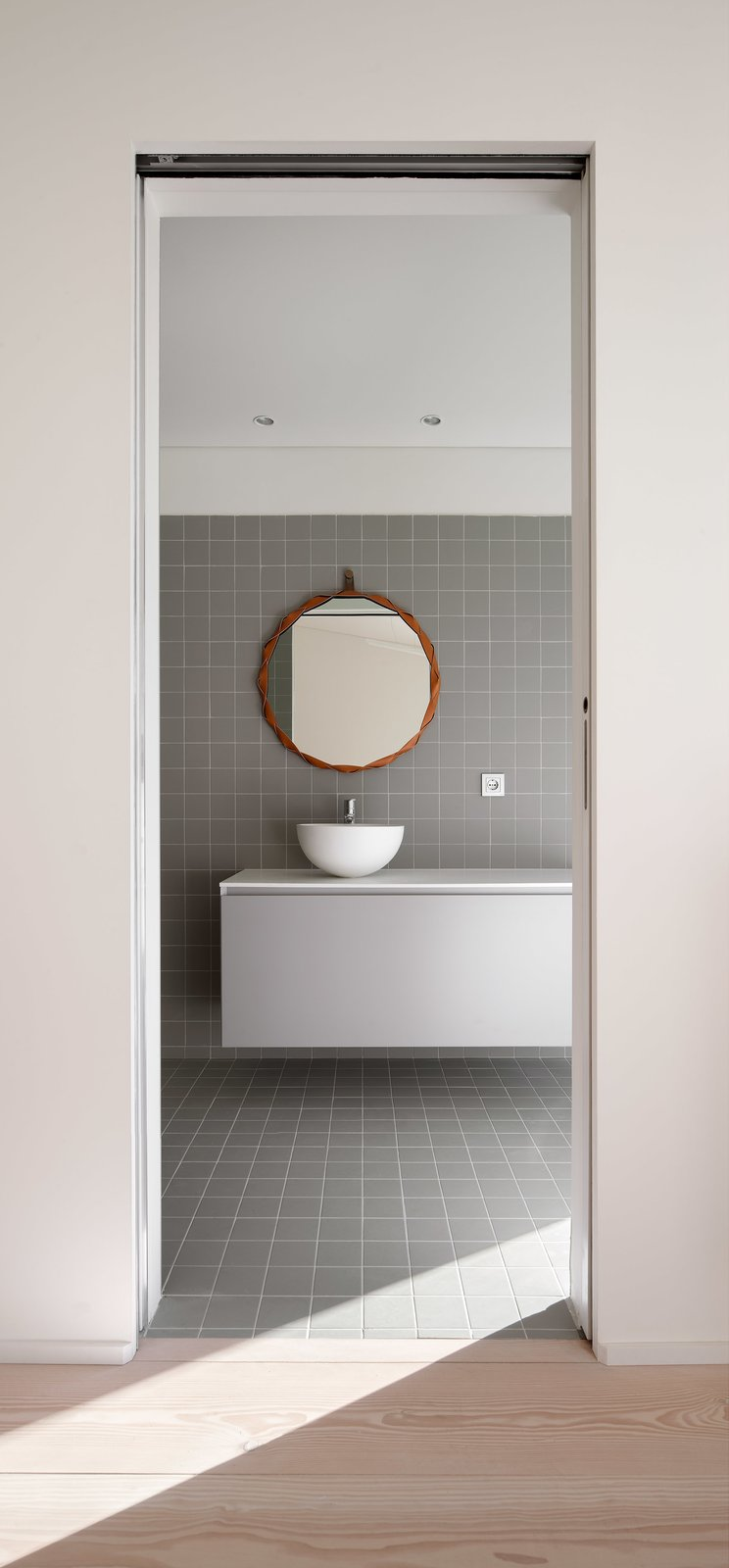 Tagged: Bath Room, Light Hardwood Floor, Vessel Sink, and Ceramic Tile Floor.  The Öcher House by MLMR Architecture Consultancy