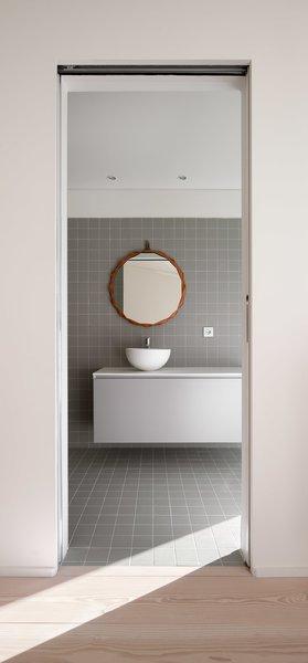 Modern home with bath room, light hardwood floor, vessel sink, and ceramic tile floor. Photo 17 of The Öcher House