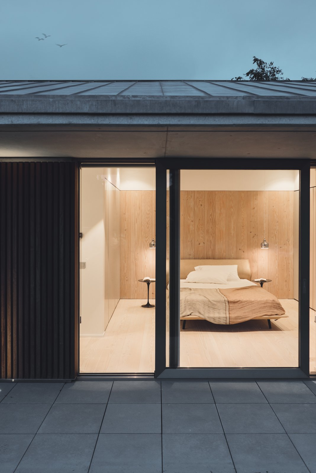 Tagged: Bedroom, Bed, Night Stands, Pendant Lighting, Ceiling Lighting, and Light Hardwood Floor.  The Öcher House by MLMR Architecture Consultancy