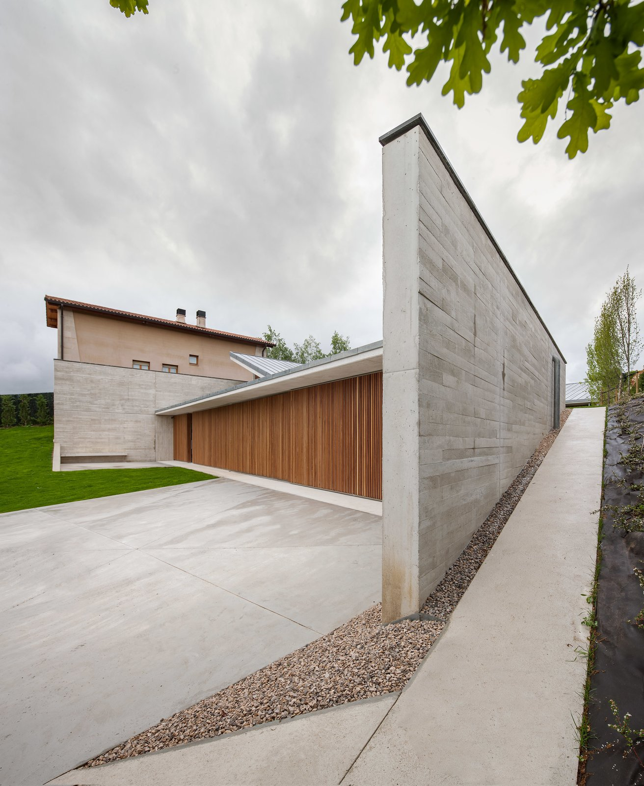 Tagged: Outdoor, Front Yard, Gardens, Garden, Wood Patio, Porch, Deck, Concrete Patio, Porch, Deck, and Metal Patio, Porch, Deck.  The Öcher House by MLMR Architecture Consultancy