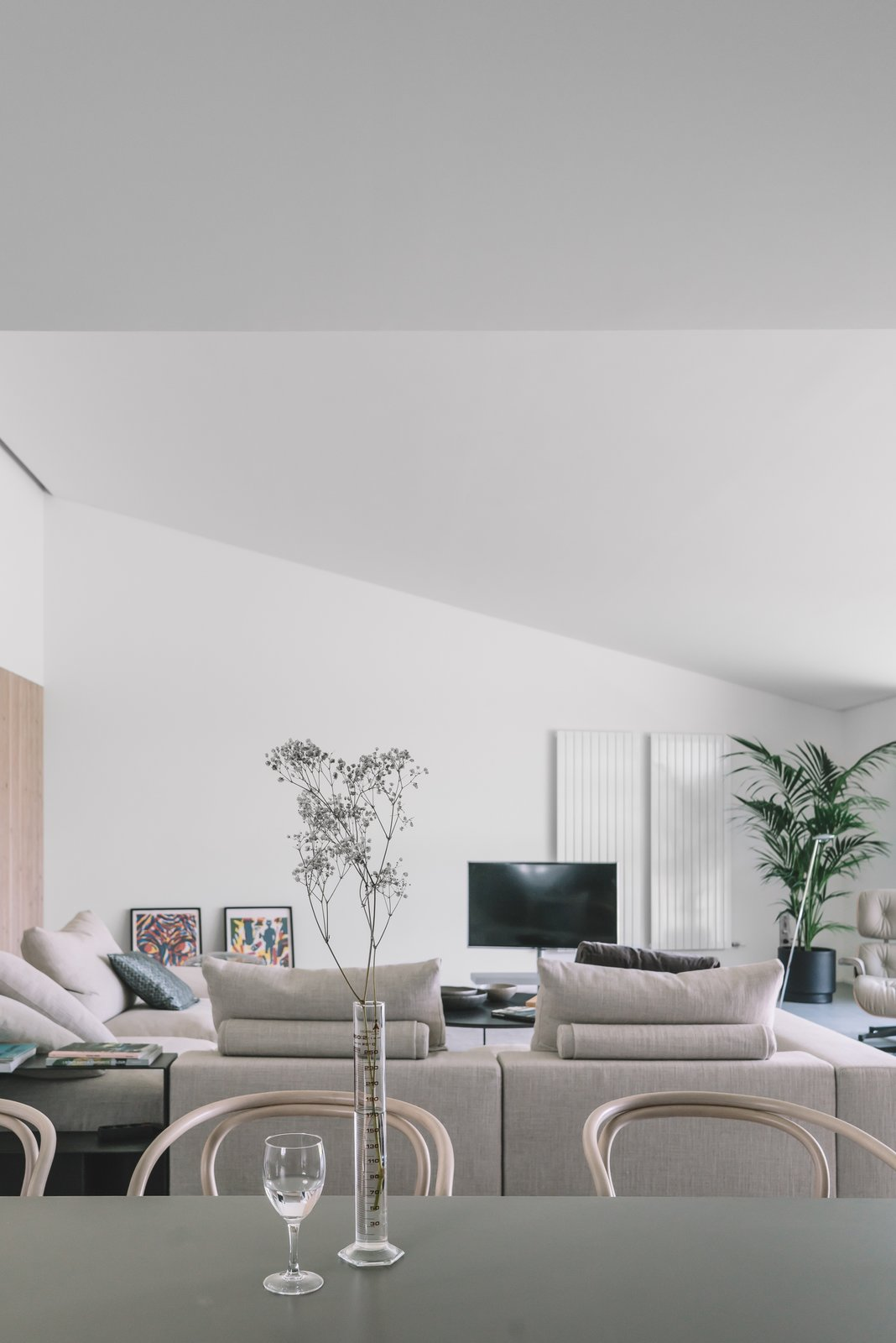 Tagged: Sofa, Recliner, Ottomans, Chair, Wall Lighting, Dining Room, and Table.  The Öcher House by MLMR Architecture Consultancy