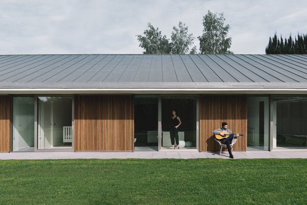 Modern home with outdoor, front yard, grass, garden, gardens, metal patio, porch, deck, wood patio, porch, deck, and concrete patio, porch, deck. Photo 6 of The Öcher House