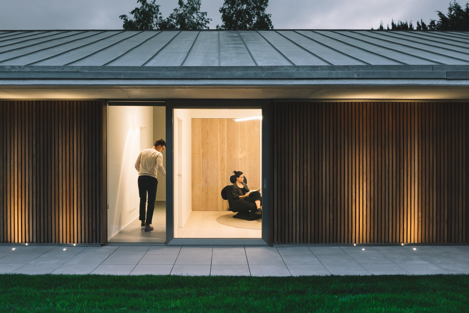 Tagged: Outdoor, Garden, Front Yard, Grass, Gardens, Wood Patio, Porch, Deck, Metal Patio, Porch, Deck, Post Lighting, and Concrete Patio, Porch, Deck.  The Öcher House by MLMR Architecture Consultancy