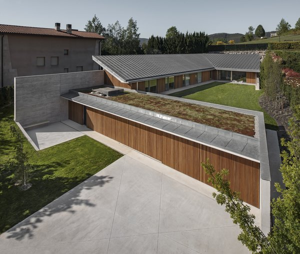 Modern home with outdoor, front yard, garden, rooftop, trees, grass, gardens, concrete patio, porch, deck, metal patio, porch, deck, wood patio, porch, deck, and wood fence. Photo 4 of The Öcher House
