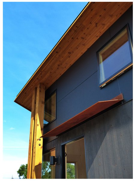 Modern home with outdoor, wood patio, porch, deck, and metal patio, porch, deck. Exterior CorTen visor Photo 3 of Roost Pre-Fab Cottages RoostDIY.com