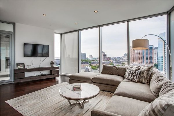 Modern home with living room, dark hardwood floor, recessed lighting, and sofa. Photo  of Modern Dallas High-Rise