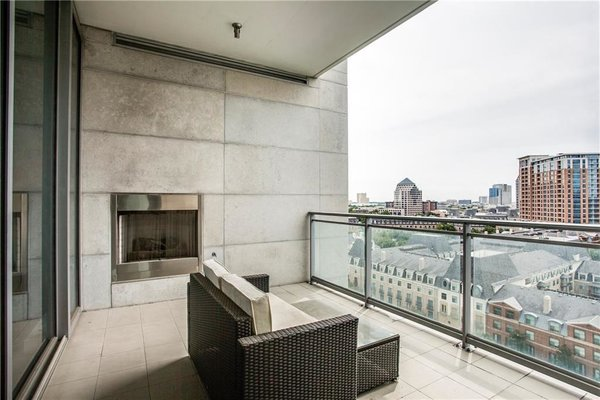 Enjoy skyline views from your huge terrace with modern fireplace. Photo 10 of Modern Dallas High-Rise modern home