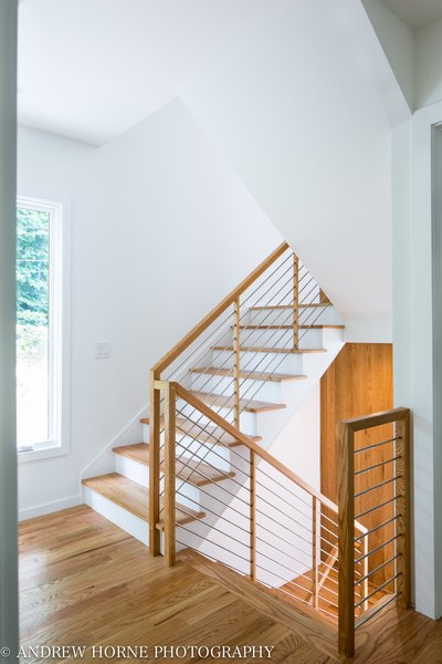 Modern home with staircase, wood tread, wood railing, and metal railing. Photo 6 of Tree House