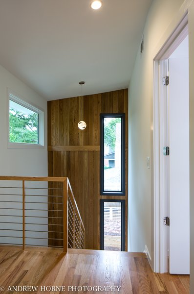 Modern home with staircase, wood tread, wood railing, and metal railing. Stainless steel stair and White Oak accent wall Photo 9 of Tree House