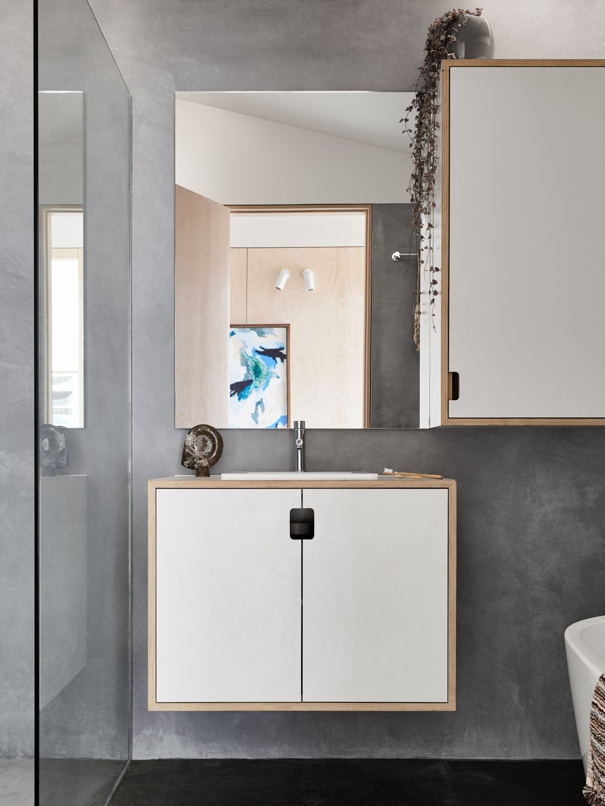 Main bathroom featuring natural, non-toxic marrakech render on walls and wet areas. Tagged: Bath Room, Concrete Floor, Wood Counter, Drop In Sink, Concrete Wall, and One Piece Toilet.  The 10 Star Home by The Sociable Weaver