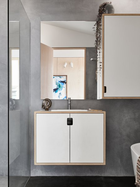 Modern home with bath room, concrete floor, wood counter, drop in sink, concrete wall, and one piece toilet. Main bathroom featuring natural, non-toxic marrakech render on walls and wet areas. Photo 6 of The 10 Star Home
