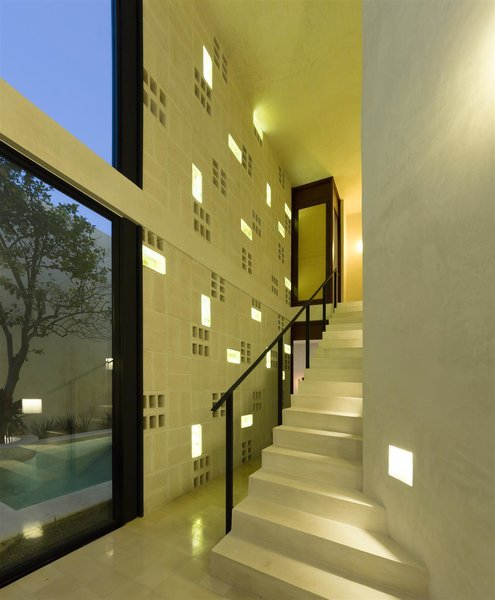 Modern home with staircase, metal railing, and concrete tread. Photo 9 of Casa RC80