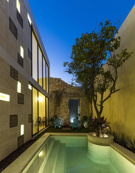 Modern home with outdoor, grass, side yard, back yard, trees, standard construction pool, small pool, and landscape lighting. Photo 10 of Casa RC80