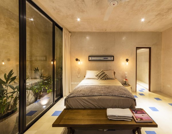 Modern home with bedroom, bed, ceramic tile floor, night stands, and ceiling lighting. Photo 2 of Casa RC80