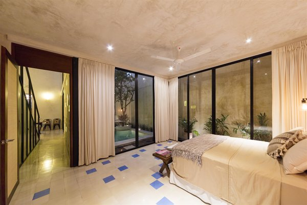 Modern home with bedroom, chair, ceiling lighting, bed, ceramic tile floor, and night stands. Photo 4 of Casa RC80