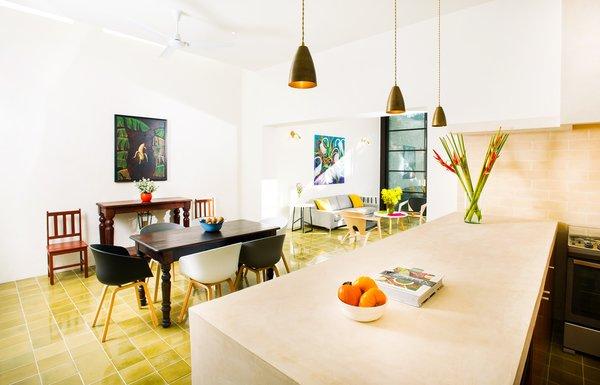 Modern home with kitchen, wood cabinet, porcelain tile floor, ceramic tile floor, concrete counter, ceiling lighting, and stone slab backsplashe. Photo 6 of Casa FS55