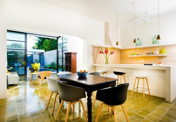 Modern home with dining room, table, chair, shelves, lamps, bar, ceiling lighting, ceramic tile floor, and porcelain tile floor. Photo 5 of Casa FS55