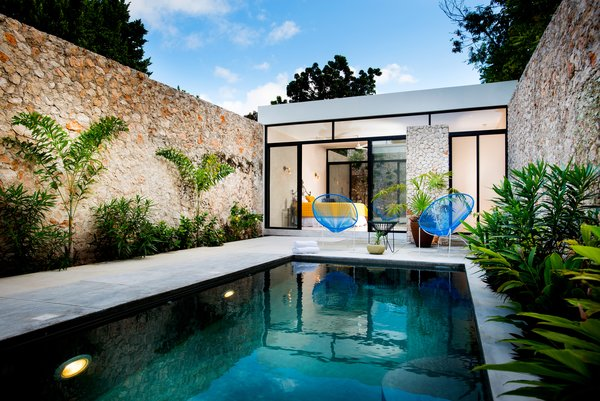 Modern home with outdoor, standard construction pool, and back yard. Photo 11 of Casa FS55
