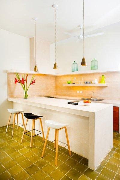 Modern home with kitchen, wood cabinet, concrete counter, ceramic tile floor, porcelain tile floor, stone tile backsplashe, and ceiling lighting. Photo 7 of Casa FS55