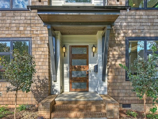 Modern home with wood, exterior, swing door type, and doors. The front door with oversized stoop with wingwalls  Photo 2 of Contemporary Craftsman Home