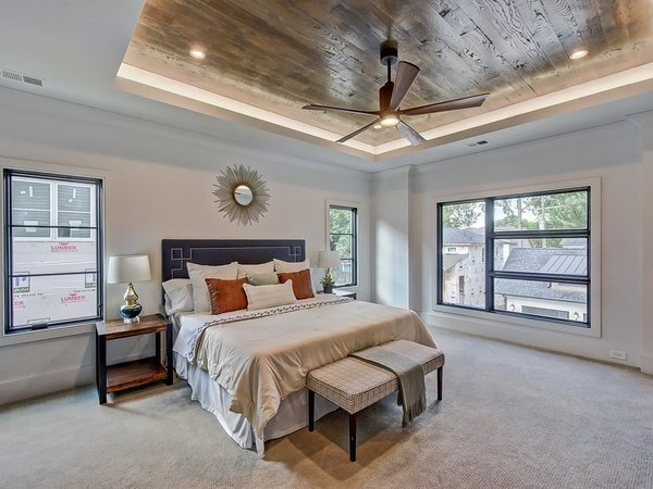 Modern home with bed, ceiling lighting, night stands, recessed lighting, accent lighting, carpet floor, windows, casement window type, and metal. Master bedroom with wood inlayed tray ceiling and LED uplighting Photo 13 of Contemporary Craftsman Home