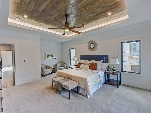 Modern home with bedroom, night stands, dresser, ceiling lighting, bed, accent lighting, recessed lighting, and carpet floor. Sitting area in master bedroom Photo 14 of Contemporary Craftsman Home