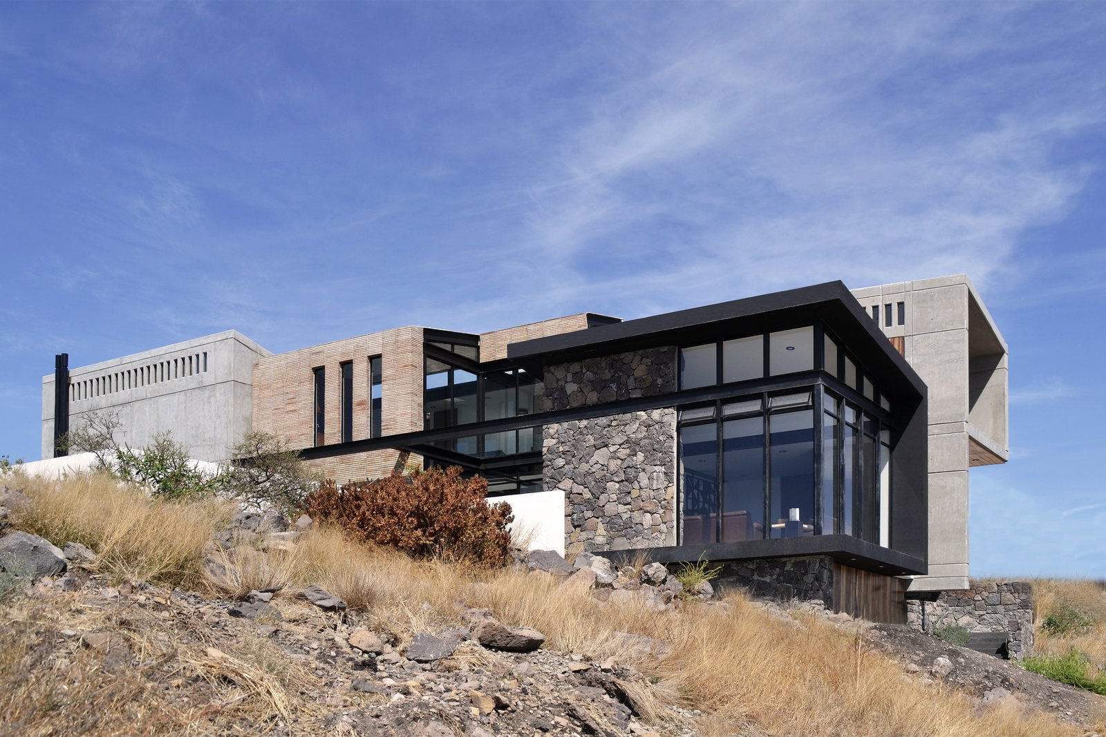 Southeast Facade Tagged: Outdoor, Front Yard, Grass, and Hardscapes.  Casa AB by e|arquitectos