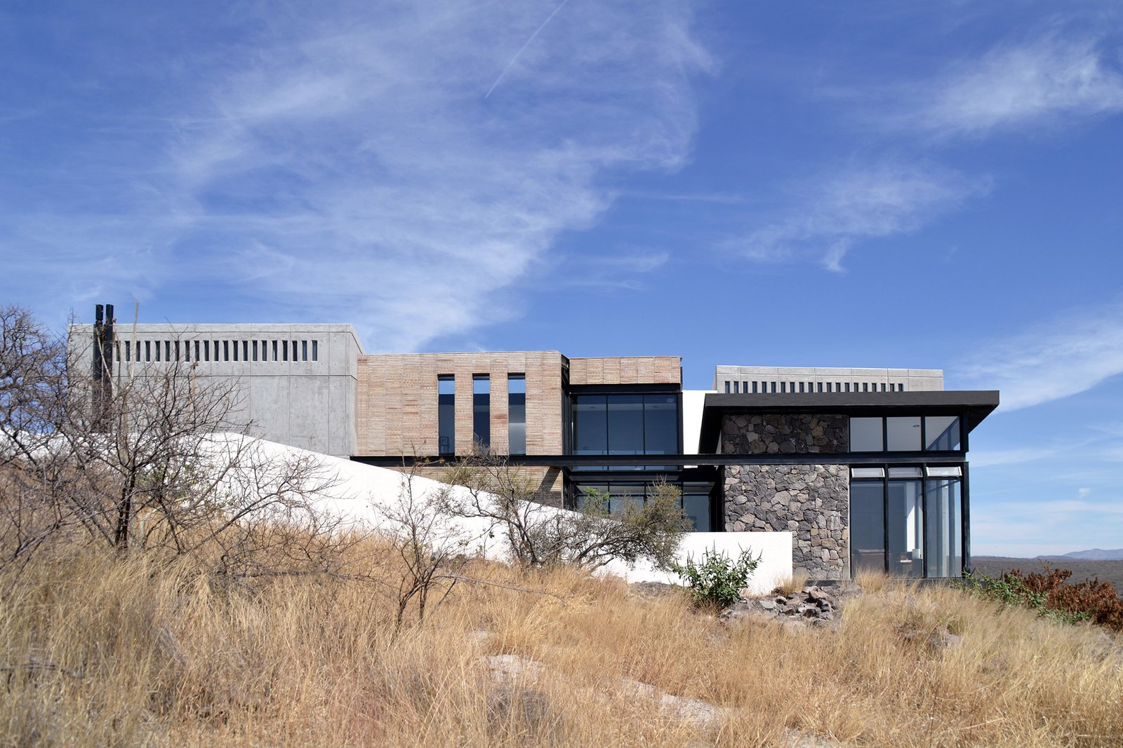 South Facade Tagged: Outdoor, Field, Grass, and Hardscapes.  Casa AB by e|arquitectos