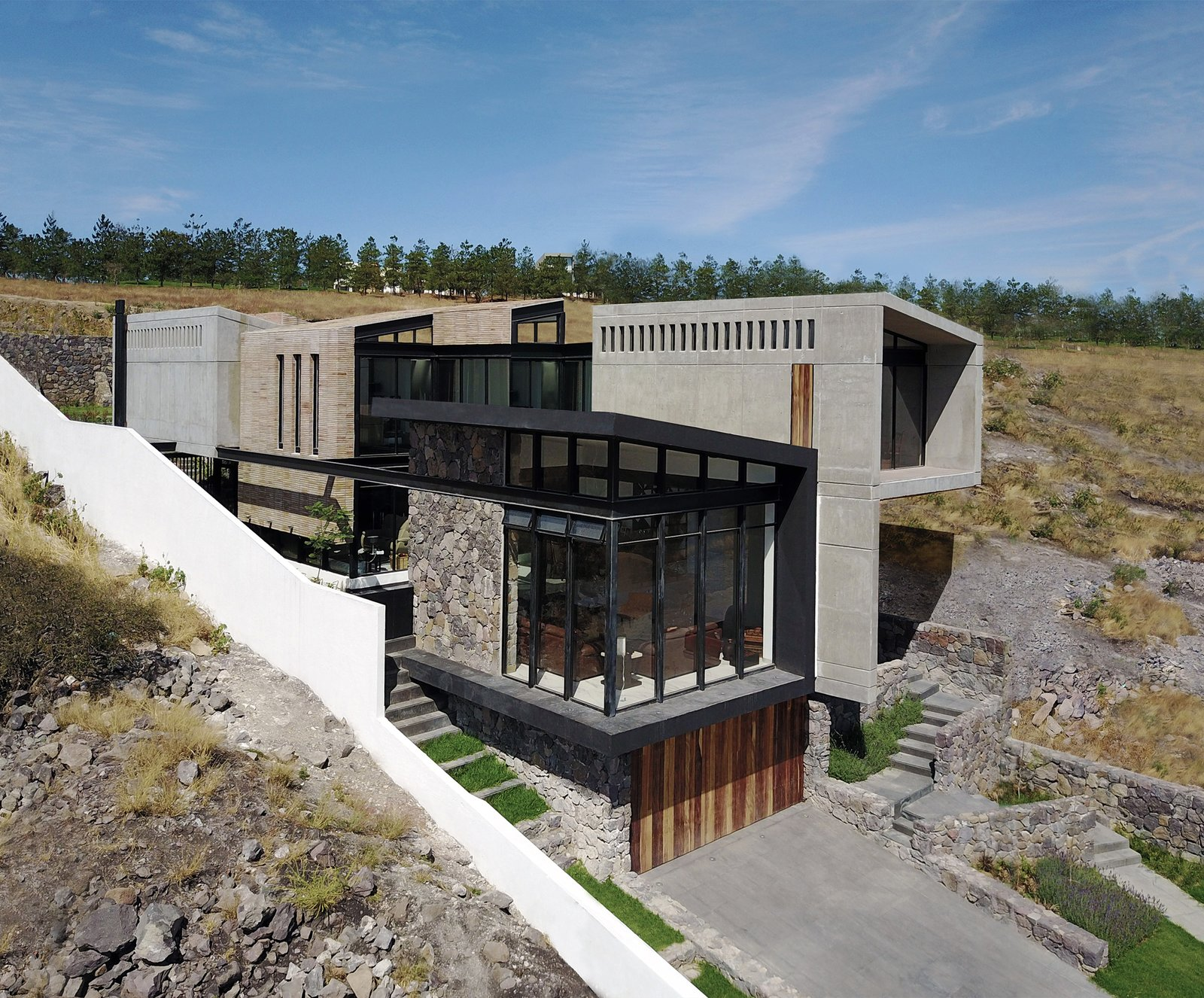 Aerial View - Southeat Facade Tagged: Outdoor, Grass, Front Yard, and Field.  Casa AB by e|arquitectos