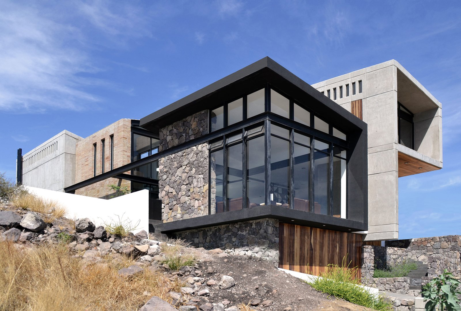 Southeast Facade Tagged: Outdoor, Front Yard, Hardscapes, and Grass.  Casa AB by e|arquitectos