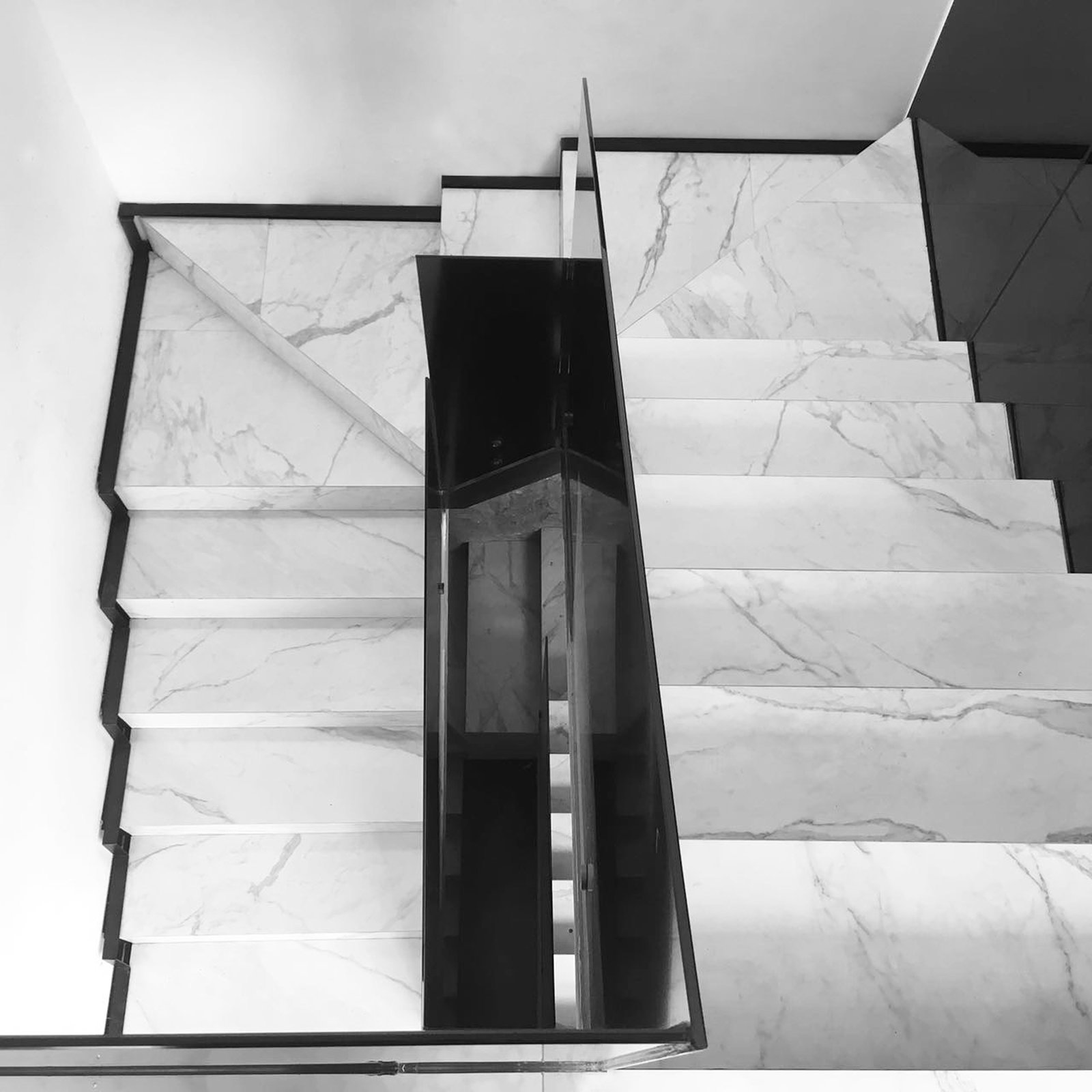 Main Stairs Tagged: Staircase, Stone Tread, and Glass Railing.  Casa AB by e|arquitectos
