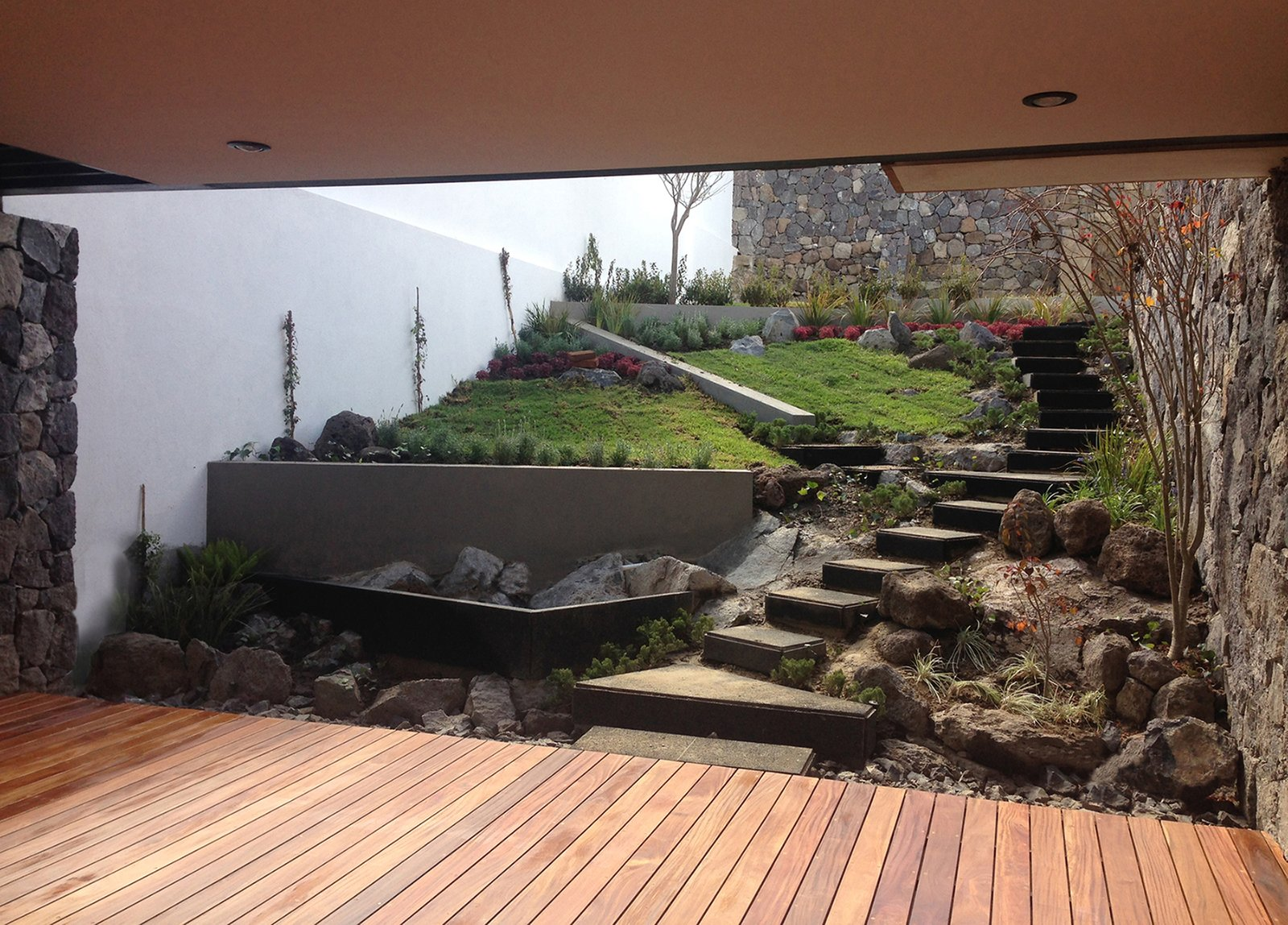 Terrace Tagged: Outdoor, Stone Patio, Porch, Deck, Wood Patio, Porch, Deck, Large Patio, Porch, Deck, Decking Patio, Porch, Deck, Garden, Hardscapes, Flowers, and Gardens.  Casa AB by e|arquitectos