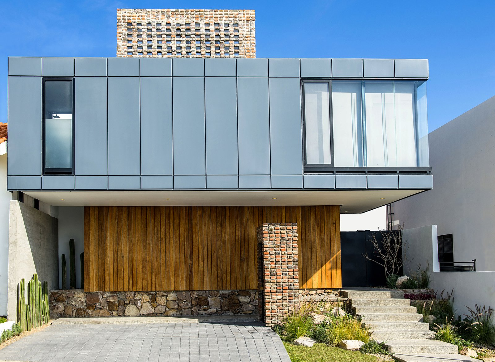 North Facade Tagged: Outdoor, Front Yard, Flowers, Grass, Gardens, and Hardscapes.  Casa MA by e|arquitectos