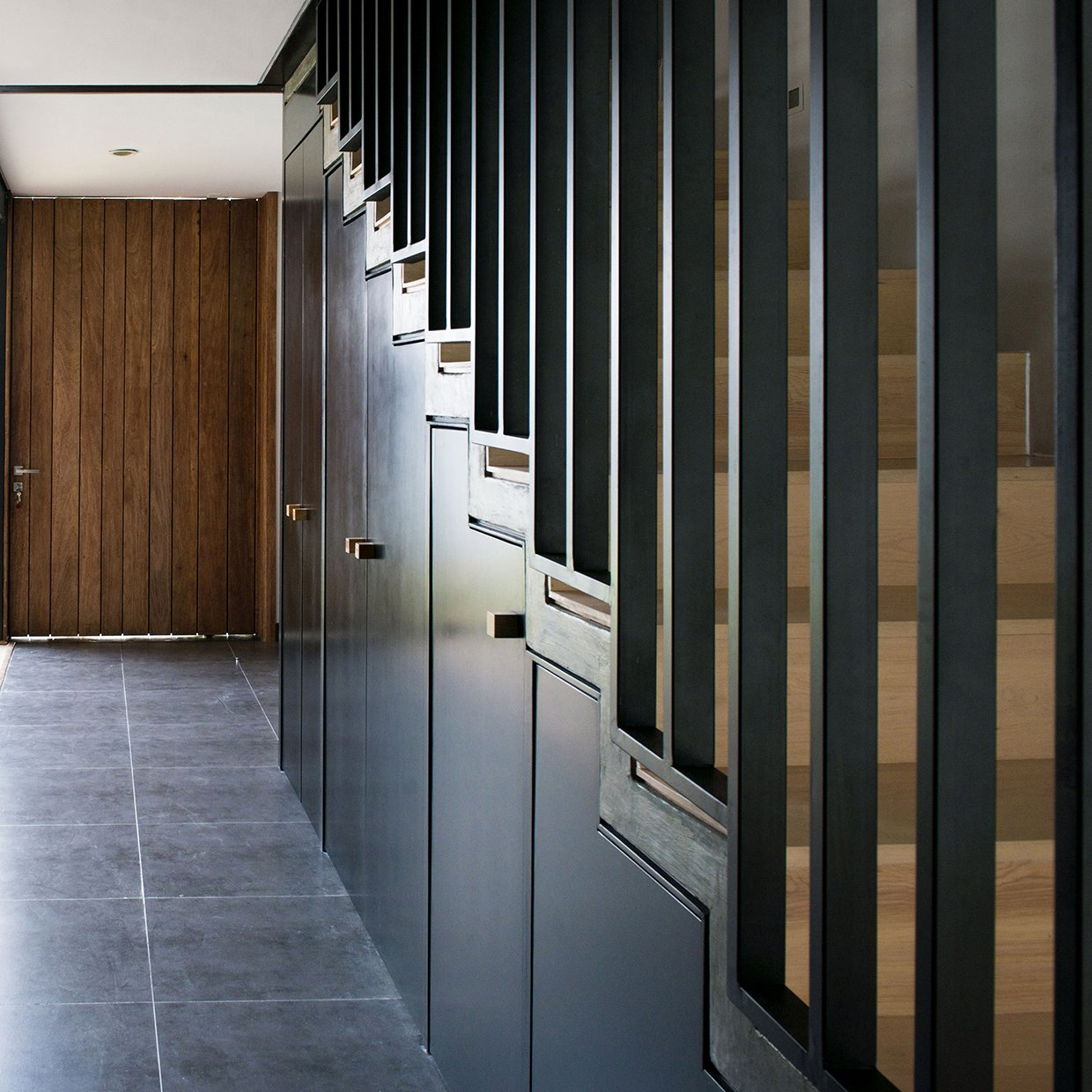 Stairs / Under stairs Closet Tagged: Metal Railing, Storage Room, Concrete Tread, Wood Tread, and Under Stairs Storage Type.  Casa MA by e|arquitectos