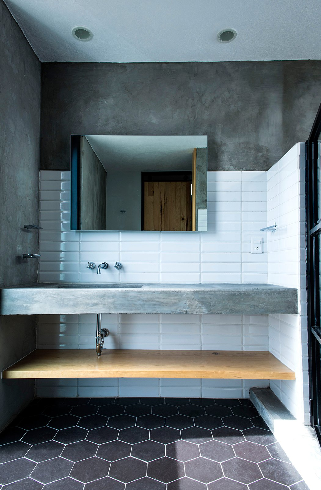 Main Bathroom Tagged: Bath Room, Concrete Counter, Undermount Sink, Ceramic Tile Floor, and Subway Tile Wall.  Casa MA by e|arquitectos