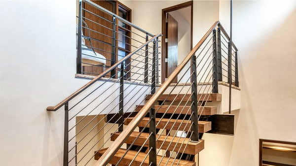 Modern home with staircase, metal tread, metal railing, wood railing, wood tread, and cable railing. Staircase Photo 12 of Beaver Dam Luxury